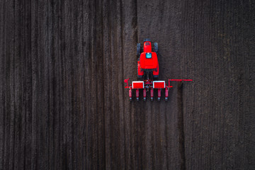 Wall Mural - Aerial view of tractor working on the harvest field