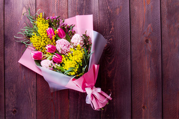 bouquet with tulips and Mimosa on a wooden table. place for text Fototapete