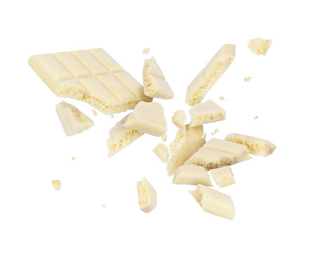 White porous chocolate broken into pieces in the air, isolated on a white background