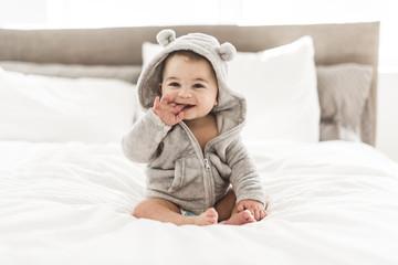 Portrait of a baby boy on the bed in bedroom Fotoväggar