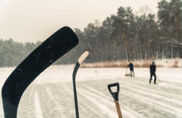 Hockey. Hockey players clear the lake to play street hockey