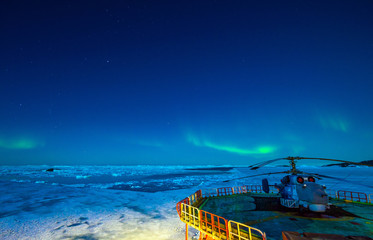 Bright colorful northern lights in the night sky. Antarctica