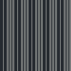 Seamless vector vertical modern stripe pattern in white with a black background. Repeat monochrome design element for prints, wrap, textile, fabric, decor.