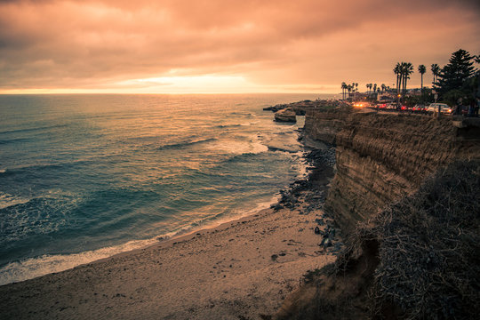 View of beautiful San Diego California seen from Sunset Cliffs in Point Loma with rocky coastline, Pacific Ocean, Palm trees