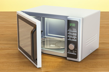 Microwave on the wooden table. 3D rendering
