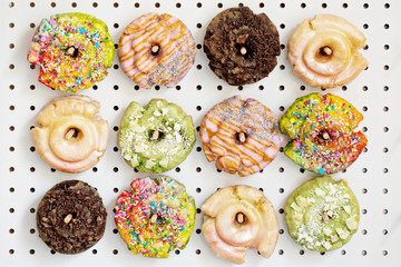 Variety of donuts on a peg board