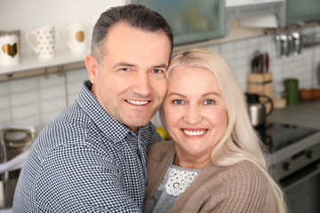 Happy senior couple in kitchen at home