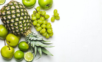 Green fruits on a white background. Fresh organic produce. Healthy food. Top view