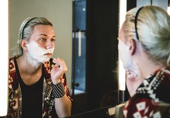 Drag queen shaving her beard