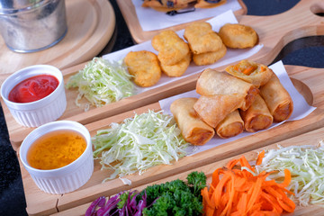 Fried Chinese spring rolls and chicken nuggets