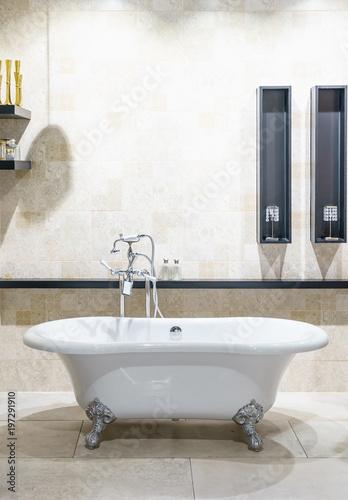 Bathroom interior in cozy colors with modern bathtub\