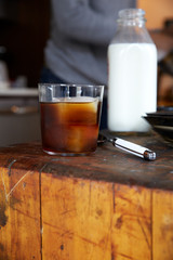 Iced coffee at home on counter with milk