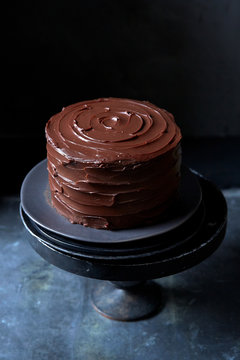 Whole Chocolate Cake with Swirled Rich Chocolate Frosting