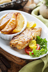 Grilled fish with roasted potatoes