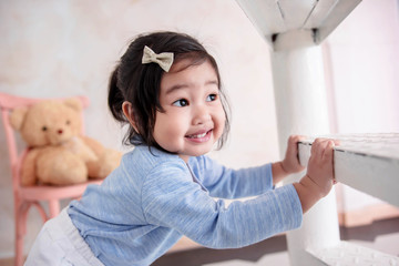 Lovely Kids Portrait, a Happy 2 Years Old Child Smiling while Playing Hide and Seek Game