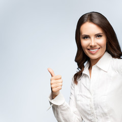businesswoman, showing thumb up gesture