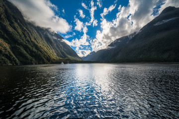 Dramatic clouds in the morning at Milford Sound in Fiordland National Park. Milford Sound is a fiord in the south-west of the Southern Island and New Zealand's most spectacular natural attraction.