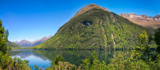 Beautiful reflections at Lake Gunn on the way to Milford Sound in New Zealand.
