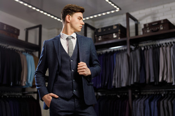 Perfect to the last detail. Modern businessman. Fashion shot of a handsome young man in elegant classic suit. Men's beauty, fashion.