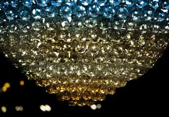 shining luxury chandelier in dark background