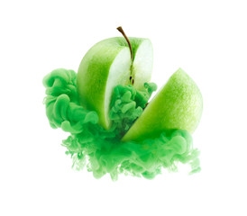 Green apple on ink isolated over white background