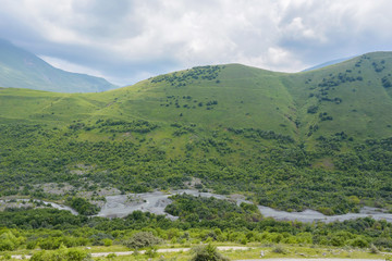 The Genaldon river in Karmadon Gorge summer view. North Ossetia, Russia. The Caucasus Mountains.