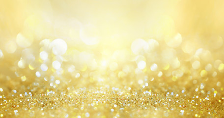 Glitter background golden saturated color ,de-focused, macro. Sparks fall and sparkle, free space.