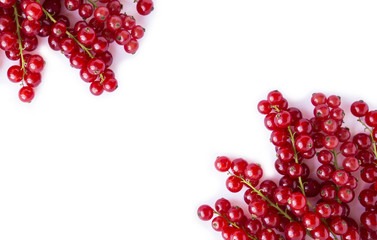 Ripe red currants on white background. Berries at border of image with copy space for text. Background berries. Top view.