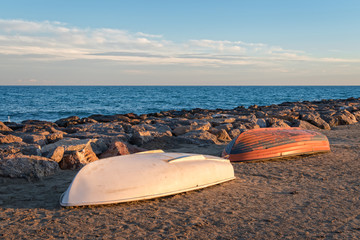 two boats stranded on the beach sand