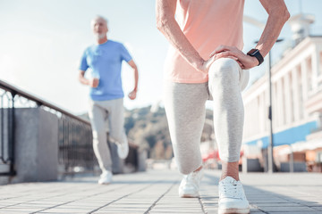Do it again. Athletic confident responsible woman spending time on fresh air having morning exercises and training.