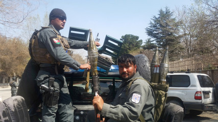 Afghan policemen arrive at the site of a blast in Kabul