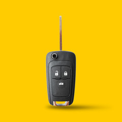 New key car on yellow background.