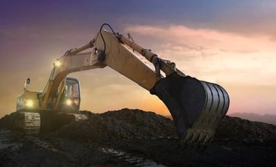 excavator on site at sunset