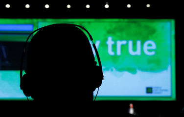 An attendee listens during the World Anti Doping Agency (WADA) Symposium in Ecublens