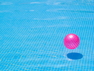 Pink ball in a swimming pool