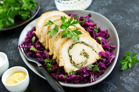 Fried pork loin stuffed with greens and red cabbage.