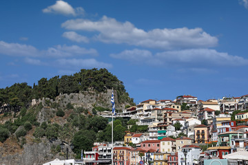old colorful houses and fortress on hill Parga Greece summer season