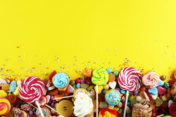 Garden Poster Candy candies with jelly and sugar. colorful array of different childs sweets and treats.
