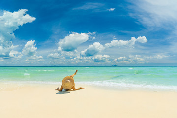WOman alone on the beach in the Caribbean islands