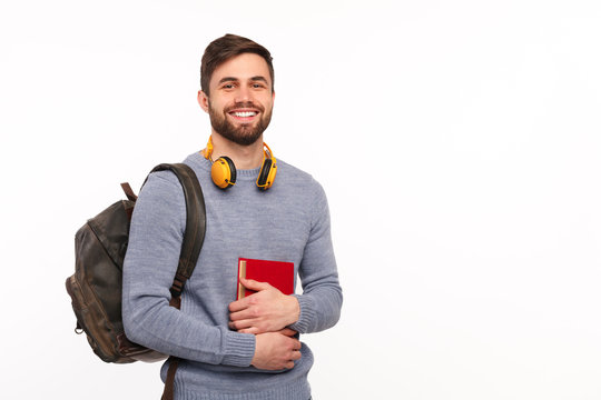 Cheerful male student with backpack