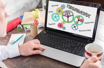 Teamwork concept on a laptop screen