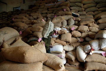 An employee carries a coffee bag at the Central Kenya Coffee Mill near Nyeri