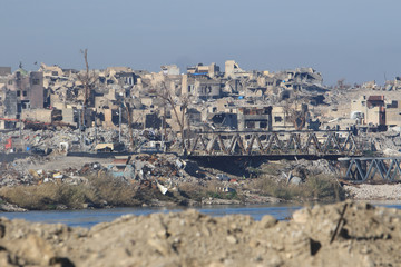 Destroyed buildings from previous clashes are seen in Mosul