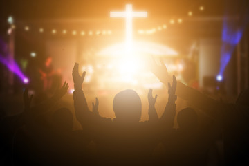 Christians raising their hands in praise and worship at a night music concert. Eucharist Therapy Bless God Helping Repent Catholic Easter Lent Mind Pray. Christian concept background.