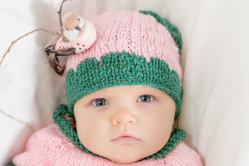 Portrait of a little girl in a pink hat. Toned image