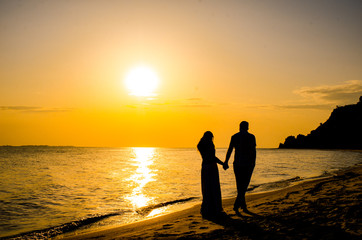 wedding couple in beautiful at sunset by the sea.
