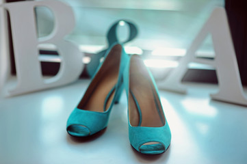 Blue turquoise color wedding bridal details at the window leather high heel shoes