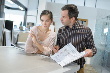 couple looking for plans of new house