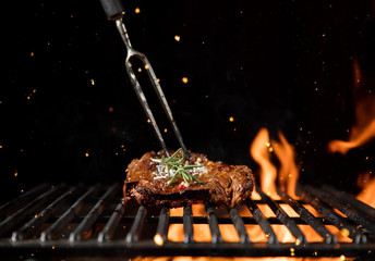 Acrylic Prints Grill / Barbecue Fiery grill grid with piece of beef steak.