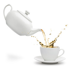 teapot pouring tea into cup on white background